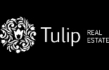 TULIP HOTELS & REAL ESTATE's business brand icon